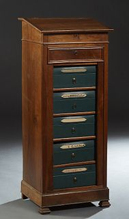 French Louis Philippe Carved Walnut Sidelock File Cabinet, late 19th c., the slanted opening lectern top over a frieze drawer and five removable cardb