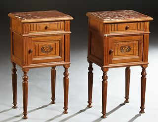 Pair of Louis Philippe Carved Walnut Marble Top Nightstands, 19th c., the inset highly figured brown marble over a frieze drawer and a pot cupboard, o