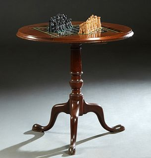 French Louis Philippe Carved Walnut Pedestal Games Table, late 19th c, the stepped circular top with an inset eglomise chess board, together with a se