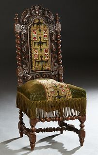 French Louis XIII Style Carved Oak Side Chair, c. 1880, the pierced winged gryphon crest over the high back with a central needlepoint cushioned panel