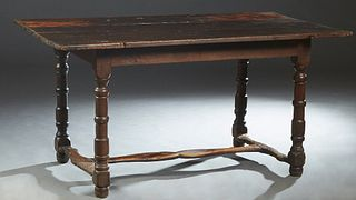 French Provincial Louis XIV Style Carved Oak Farmhouse Table, 18th c., the three board top over a wide skirt, on turned tapered and block legs joined