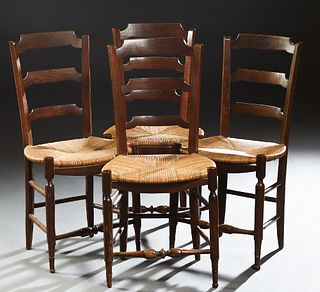 Set of Four French Provincial Carved Beech Rushseat Dining Chairs, late 19th c., the canted curved ladder back over a bowfront rush seat, on turned ta