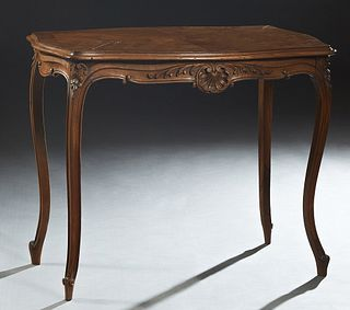 Louis XV Style Crotched Mahogany Center Table, early 20th c., the stepped ogee edge tortoise top over a shell carved skirt on both long sides, on reed