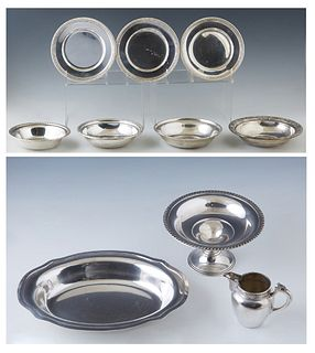 Group of Ten Pieces of Silver, consisting of an .800 creamer, #3134; a sterling compote with a gadrooned edge; 3 Gorham sterling bread plates, #180, w