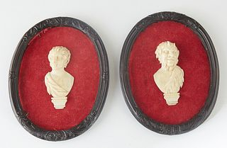 Pair of Carved Ivory Profiles, 19th c., of satyrs, now mounted on red velvet backing, in oval relief decorated shadowbox frames, H.- 2 5/8 in., W.- 1