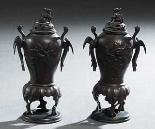 Pair of Chinese Bronze Censers, late 19th c., of tapering baluster form, with relief bird and bamboo decoration, the sides with bird handles, to tripo