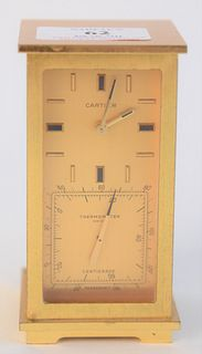 Cartier Brass Partners Desk Clock, having a thermometer and hygrometer, height 4 inches, width 2 1/4 inches, depth 2 1/4 inches.