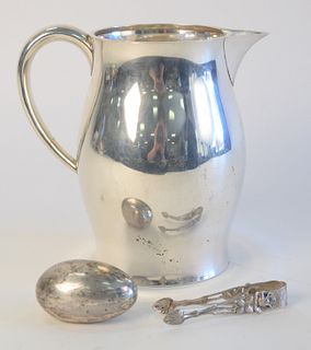 Sterling Silver Group to include Silver Pitcher, pair of tongs and Cartier sterling silver weighted egg paperweight 25.1 Toz weighable.