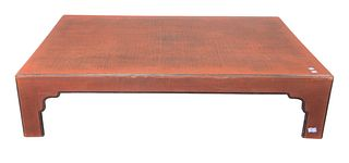 "Chinese Style Coffee Table, cloth finish under red lacquer, height 12 inches, top 34"" x 52""."