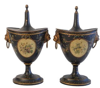 Pair of Victorian Tole Chestnut Urns, having gilt and paint decoration with finial top and lion head handles, height 11 1/4 inches.