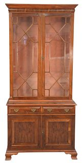 Two-Part Cabinet, with glass shelves, burlwood, on ogee feet, height 83 inches, width 38 inches.
