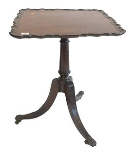 George II Mahogany Piecrust Tip Table, on turned shaft, on reeded downswept members, ending in brass paw feet, with 18th Century, height 28 inches, to