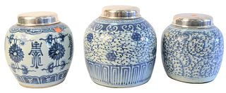 Three Chinese Blue and White Porcelain Ginger Jars, each having a silvered lid, tallest height 11 inches.