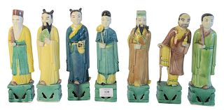 Seven Chinese Figural Porcelain Sculptures, each marked indistinctly on the underside, height of each 10 1/4 inches.