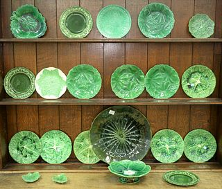 Twenty-One Piece Lot of Majolica, cabbage leaf and green plates and tableware, charger diameter 16 1/2 inches.