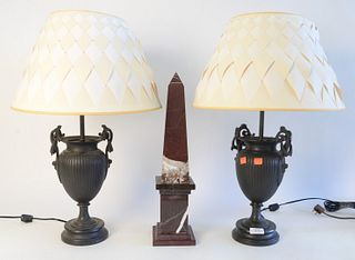 Three Piece Group, to include a pair of bronze urns with wreath handles, made into table lamps, height 12 1/2 inches; along with a rouge marble obelis