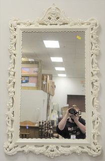 """Chippendale Style Mirror, having white painted frame with carved scrolling vine and flowers, 50"""" x 30""""."""