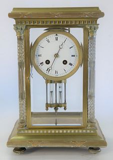 Regulator Clock, brass, glass, and crystal, having cut crystal columns, height 12 1/2 inches.