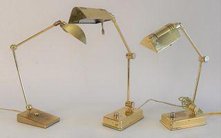 Five Brass Lamps, to include pair of brass adjustable Holtkotter Leuchten floor lamps; along with a pair of Holtkotter Leuchten and a single adjustabl