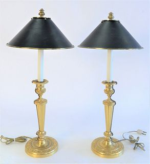 Pair of French Gilt Bronze Candlesticks, made into table lamps, with tole shades, height 23 inches.