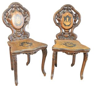Pair Black Forest Side Chairs, with open, carved backs, and inlaid back and seats, height 38 inches.