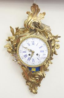 Louis XV Style French Wall Clock, brass with porcelain dial, small hairline in dial, height 19 inches.