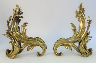 Pair of Louis XV Style Bronze Chenets, modeled as stylized acanthus leaf, marked Made in Germany, height 15 inches.