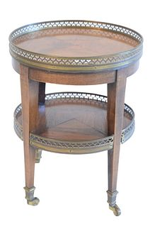 Continental Two Shelf Side Table, with brass gallery tops, on square tapered legs, ending in brass casters, height 15 inches, diameter 12 inches, (one