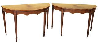 Pair Mahogany Demilune, with carved skirts, height 30 inches, width 47 1/2 inches, depth 23 inches.