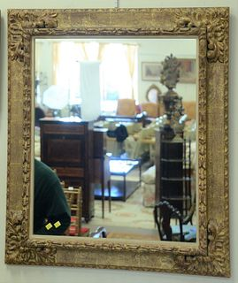 """Pair of Contemporary Continental Style Giltwood Mirrors, having foliate carved corners, 38 3/4"""" x 33 3/4""""."""