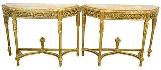 Pair of Gilt Demilune Tables, with rouge marble tops with pierce carved friezes, set on carved and fluted legs, with urn finials, (marbles professiona