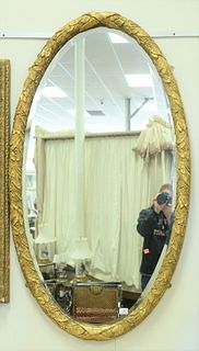 """Pair Oval Gilt Mirrors, with foliate frames, 32"""" x 58""""."""
