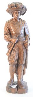 Carved figure of a European Figure, wearing a hat with a feather, 18th or 19th century, height 21 inches.