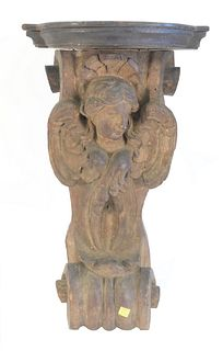 Putti carved shelf with wings set on scroll, height 25 inches, width 14 inches.