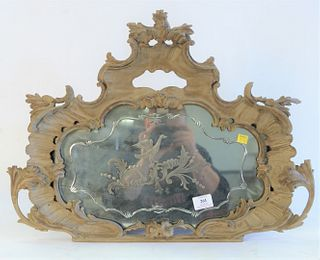 Rococo style mirror with etched bird design, 19th century, height 18 inches, width 24 inches.