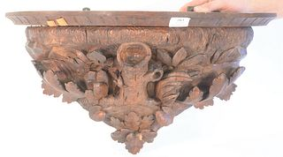 Black Forest Shelf, having carved leaves and stump, (1 chip at base), height 12 inches, length 24 inches.