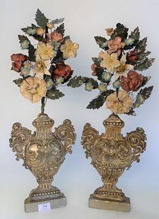 Pair of Baroque Mantle Garnitures, having embossed tin urn with metal painted flowers, height 24 inches.