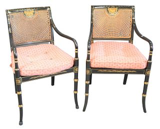 Set of Five Black Stenciled Armchairs, with caned backs and seats, back caning with imperfections, seat caning supported by wood, arms worn on three c