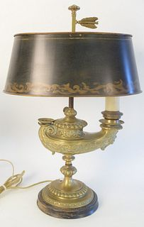 Brass Electrified Oil Lamp, with one light and tole shade, height 22 inches.