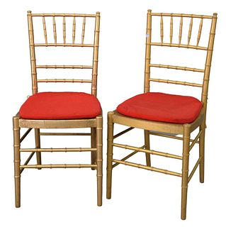 Set of Ten Faux Bamboo Chairs, gold with red slip seats, seat height 17 1/2 inches, total height 36 inches.
