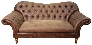Contemporary Brown Leather Upholstered Sofa having rolled arms with tufted upholstered back and arms, length 74 inches.