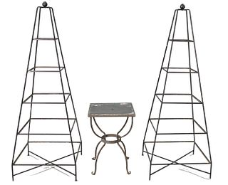 Three piece group to include two Obelisk form etagere with glass shelves along with a slate top table, height 69 inches, width 25 inches.