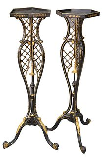 Pair of Victorian Black Lacquered and Gilt Decorated Fern Stands, having hexagon tops over pierced shaft, raised on tripod base, height 44 inches.