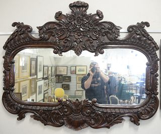 Large French Style Mirror with carved frame, height 47 inches. width 58 inches.