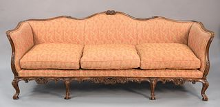 Louis XV Style Sofa, with custom upholstery with carved frame, height 33 inches, length 92 inches. Provenance: Matthes-Theriault Collection, Woodbridg