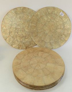 Fourteen Kim Seybert Round Capiz Shell Placemats, retails for $380 for a set of four, diameter 15 inches.