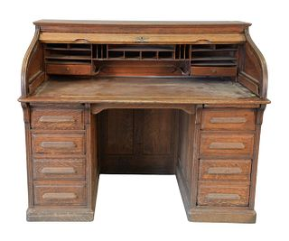 Oak S-Roll Top Vetter Desk, height 44 1/2 inches, width 54 inches Provenance: The Estate of Diana Atwood Johnson.