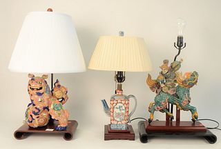Three Piece Lot of Chinese and Japanese Table Lamps, to include one porcelain foo dog on a scroll base; one porcelain warrior riding a dragon on black