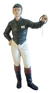 Cast Iron painted Hitching post, modelled as a jockey, height 48 inches, purchased from Christie's, South Kensington, September 27, 2000.