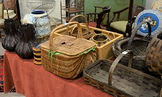 Large Lot of Baskets, on top and under a table.